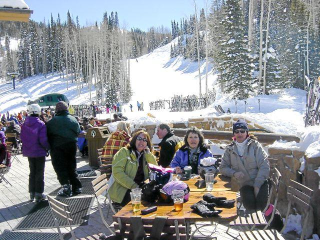 Skiers relaxing slopeside