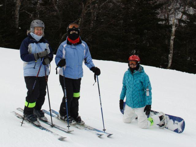 Skiers and snowboarder on the slopes at Wildcat, New Hampshire