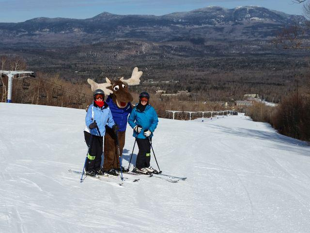 Skiers with moose mascot at Sunday River